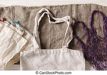 eco natural reusable bags for shopping, flat lay on rustic background. sustainable lifestyle concept. zero waste. plastic free items. ban plastic. reuse, reduce, recycle, refuse