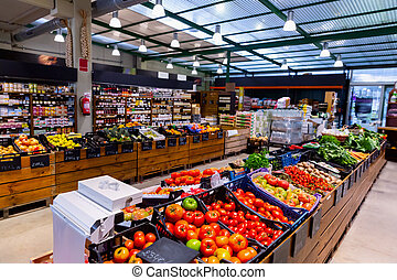 Eco products store counter with large assortment of vegetables