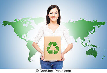 Eco, recycling, and a world saving concept. Woman with a paper bag with ecology symbol. World map background.