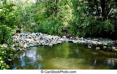 Eco What? - A dam of pet containers polluting the stream.