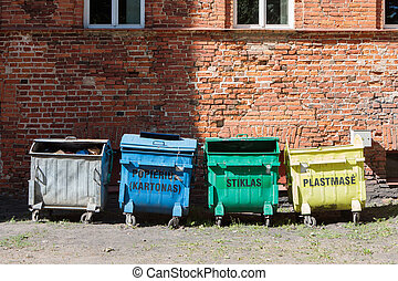 Ecologic concept - trash sorting into the multic-colored...