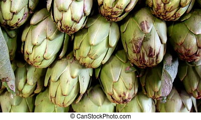 Ecological big artichokes piled - Big artichokes piled in...