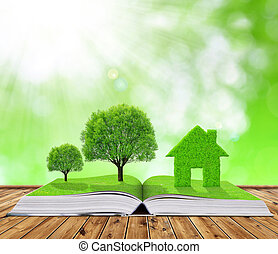 Ecological book with trees and house on table