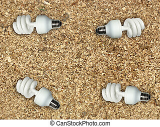 Ecological concept light bulb on wooden chips background