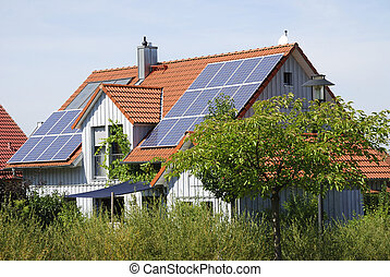 Ecological house - Solar panels on the roof of a house...