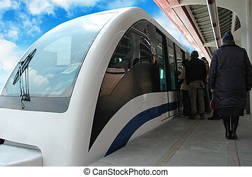 Ecological transport - Commuters boarding modern train. ...