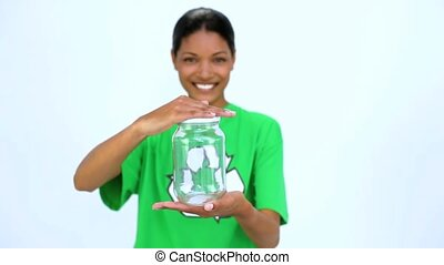 Ecological woman holding jar and does thumbs up at camera on...