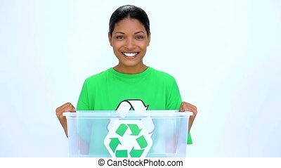 Ecological woman holding recycling bin on white background