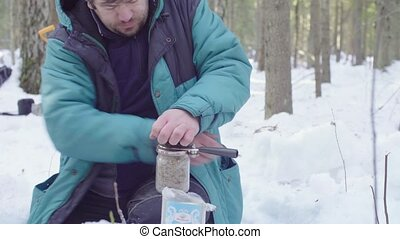 Ecologist closing jars with soil samples - Scientist...