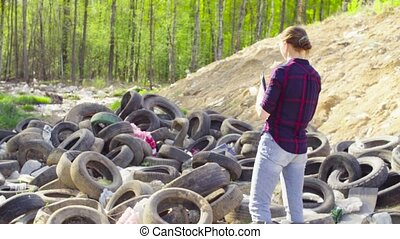 Ecologist during the research on garbage dump. - Woman...