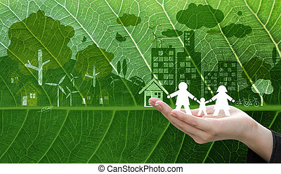 Ecology concept design of business woman hand holding white paper family symbol on fresh green leaf texture background