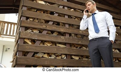 ecology concept. the businessman in thought walks around the...