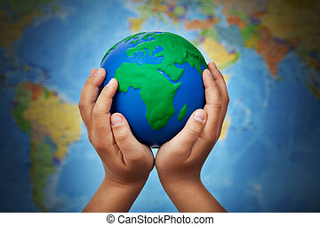 Ecology concept with earth in child hands