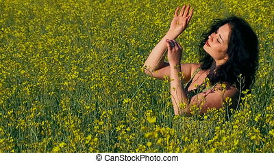 Ecology. Girl playing with flowers.