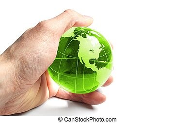 ecology concept with hand and glass globe isolated on white...