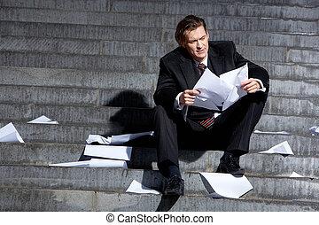 Econimic crisis - Portrait of depressed employee sitting in...