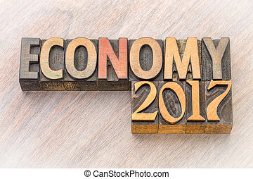 economy 2017 word abstract in wood type