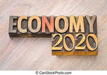 economy 2020 word abstract in wood type