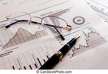Business background with graphics, glasses and pen