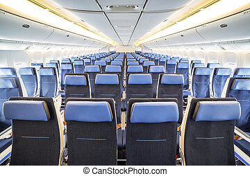 Economy class in an airplane - Freshly renovated interior of...