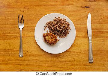 economy food. rissole and buckwheat groats