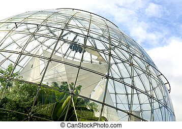 spheric structure made of glass and iron with plants inside