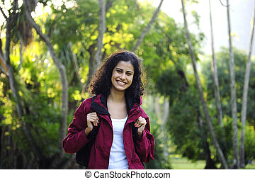 ecotourism: woman hiking in the forest - ecotourism: happy...