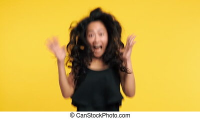 Ecstatic asian woman jumping with joy celebrating success....