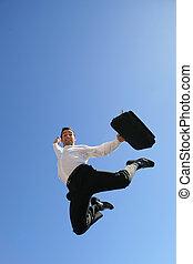 Ecstatic businessman leaping through the air