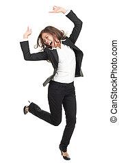 ecstatic businesswoman in suit dancing