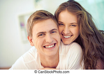 Ecstatic couple - Portrait of joyful young people looking at...