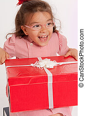 Ecstatic little girl with present