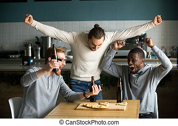 Ecstatic men celebrating victory watching game on smartphone, sp