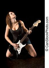 Ecstatic rock guitarist woman