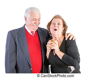 Ecstatic senior woman receiving a Valentines gift