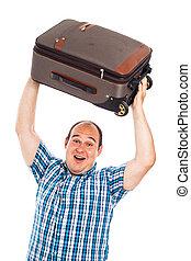 Ecstatic traveler lifting up his luggage