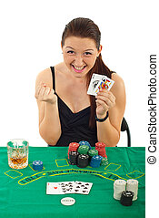 Ecstatic woman won at black jack and sitting at casino table