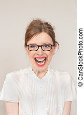 Ecstatic - Young girl with eyeglasses showing ecstatic face