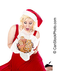 ecstatic young woman looking at christmas cookies