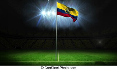 Ecuador national flag waving on flagpole against football...
