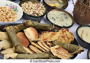 A display of Ecuadorian breads, pancakes, wraps and sauces for sale at an outdoor food market in Cotacachi, Ecuador