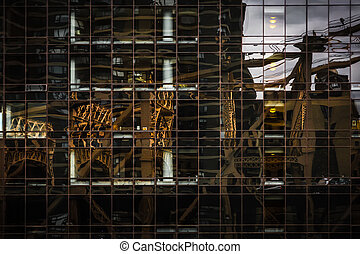 Ed Koch Queensboro Bridge reflection in the glass surface of a modern building in Manhattan