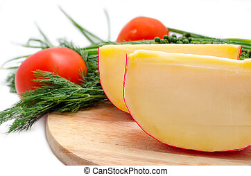 Edam cheese and a piece on cutting board - Edam cheese with...
