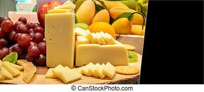Edam Cheese - edam cheese with variety of fruit and cracker...