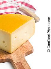 edam cheese on cutting board