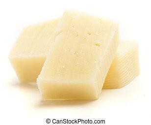 edam cheese pieces on a white background