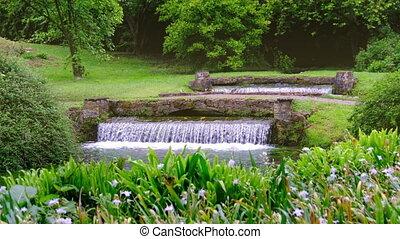 eden garden fountain 4k waterfall background Nymph Garden or...