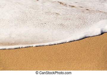 Edge of sea and surf on sandy beach