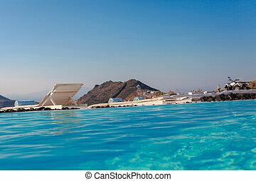 Edge of swimming pool on the cliff of Santorini, Greece
