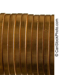 Edge view of stack of golden coins